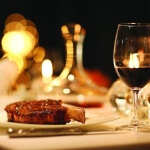 Steak with glass and carafe of wine