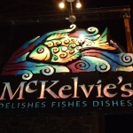 Logo of colourful fish with name of restaurant