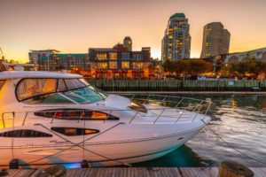 Boat at dock with Halifax skyline at sunset in background