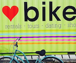 """Bike in front of colourful wall painted with a heart and """"bike"""""""