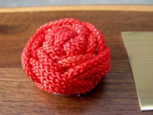 Ball of red rope from Arts of the Sailor