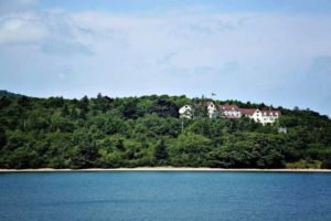 Signature Resort on hill overlooking waterfront