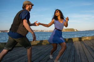 Couple Swing Dancing at Waterfront