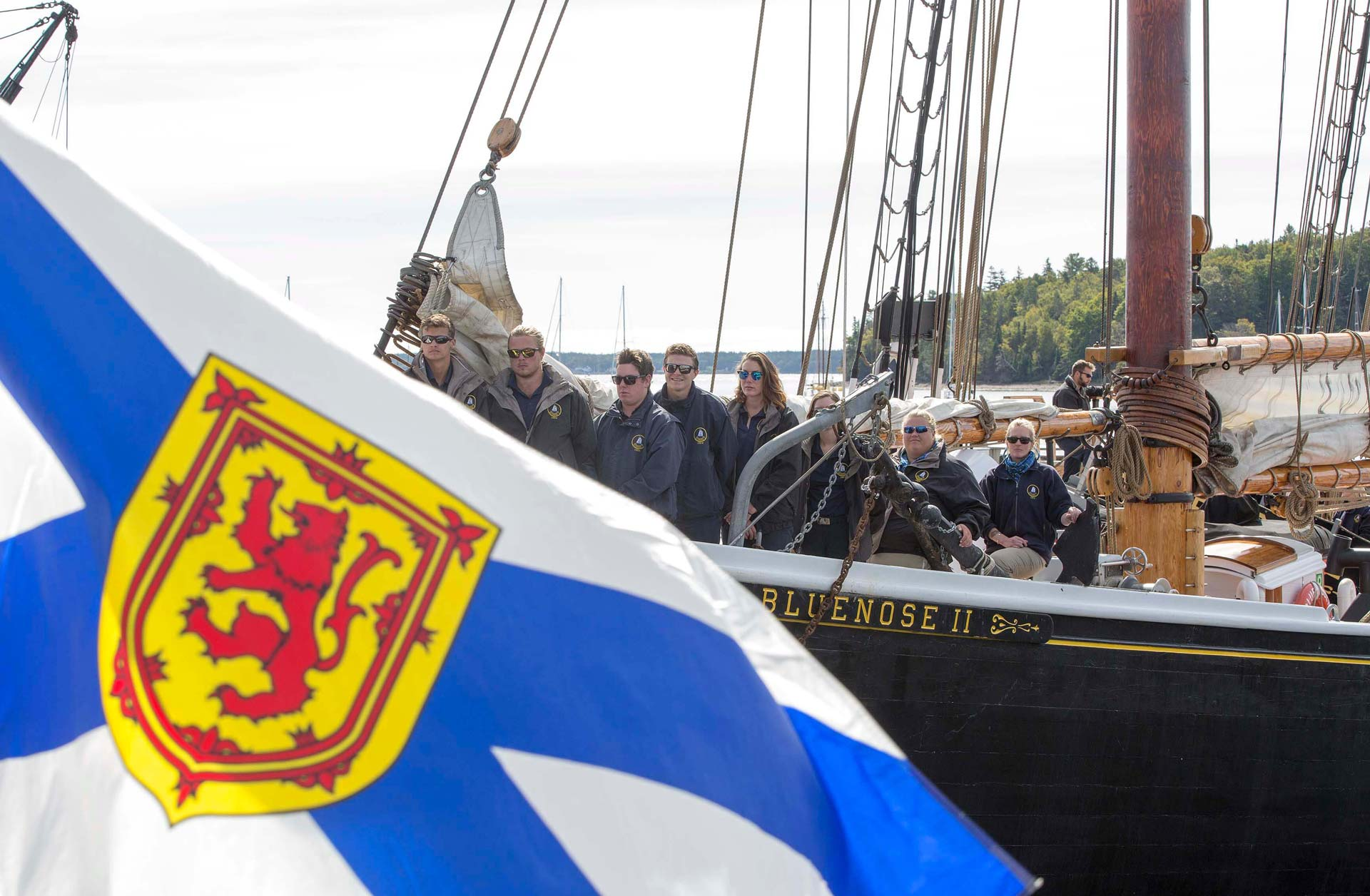 Nova Scotian Flag in front of Tall Ship